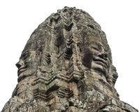 Stone faces. Bayon Temple - Angkor Area, isolated on white background royalty free stock photos