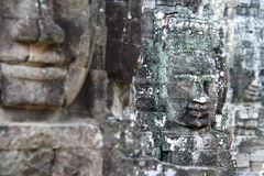 Stone faces in Angkor Wat Royalty Free Stock Photography