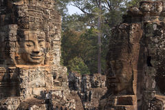 Stone faces in Bayon temple in ancient city Angkor Royalty Free Stock Photo