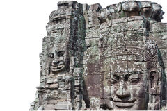 Stone faces, Bayon Temple - Angkor Area. Isolated on white background royalty free stock photo