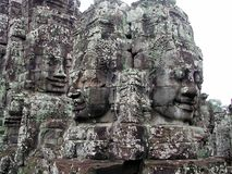Stone faces in cambodia. Carved stone face in Ankor Wat, cambodia Royalty Free Stock Photos