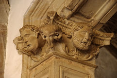 Stone faces. Carving in a column Stock Photo