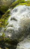 Stone faces. Face carved into ruined stone walls above the Big Water of Fleet, Galloway Royalty Free Stock Photo