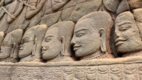 Stone faces of Khmer warriors Royalty Free Stock Photo