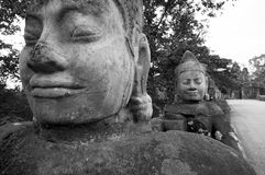 Faces of the Causeway, South gate, Angkor Thom Stock Images