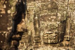 Stone faces on the towers of ancient Bayon Temple Royalty Free Stock Images