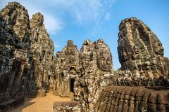 Stone faces on the towers of ancient Bayon Temple Stock Photos