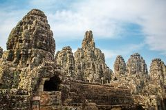 Stone faces on the towers of ancient Bayon Temple Stock Image