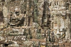 Stone faces on the towers of ancient Bayon Temple Stock Photo