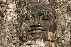 Stone faces on the towers of ancient Bayon Temple Royalty Free Stock Photo