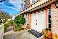 Stone facing fabulous house. Entrance white wooden doors Stock Images