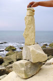 Stone fancy shaped face on beach Royalty Free Stock Photo