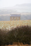 Stone Farmhouse Against Snowy English Landscape Royalty Free Stock Images