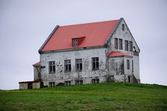 Stone farmhouse on hill, Iceland Royalty Free Stock Images