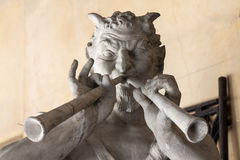 Stone faun. At street market Royalty Free Stock Photography