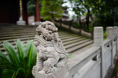 Stone female lion on balustrade before ancient Chinese building Royalty Free Stock Image
