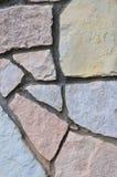 Stone fence background, vertical stonewall closeup, decorative limestone dolomite calcium carbonate hard sedimentary slate slab Stock Image