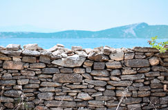 Stone fence. Overlooking the sea and the island Royalty Free Stock Images