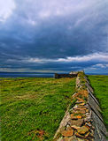 Stone fence in the pasture lands near the Cliffs of Moher Royalty Free Stock Photos