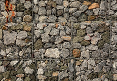 Stone fence protected by applicable Grids Stock Photography