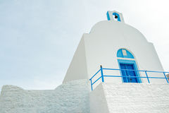 Stone fence and traditional white blue Christian. Orthodox church in Greece low angle view Stock Photo