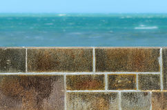 Stone fence wall and sea Royalty Free Stock Photography