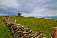 Stone fenced path to Moher Tower along the Cliffs of Moher Stock Photos