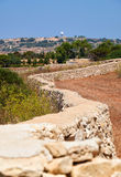 The stone fences stretch across the fields of Qrendi, Malta. Royalty Free Stock Photo
