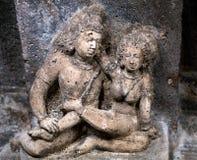 Stone figure of Bharvahaka Yaksha in Ajanta caves, India. Stone figure of lovers in Ajanta caves, India. The Ajanta Caves in Maharashtra state are about 30 rock Stock Image