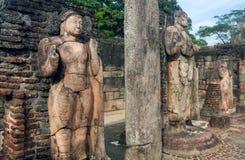 Stone figure of standing Buddha in broken 12th century buddhist temple, Sri Lanka. Ancient town Polonnaruwa. stock images