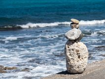 Stone figure on the waterfront, Crete, Greece stock image