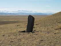 Stone figure in the Steppe, sacred place. Royalty Free Stock Photography