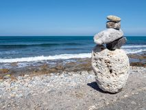 Stone figure on the waterfront, Crete, Greece royalty free stock photography