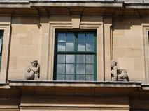 Stone figures on art-deco window. At palace in Eltham, london royalty free stock images