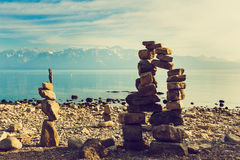 Stone figures on beach shore of Geneva lake in Switzerland Royalty Free Stock Photography