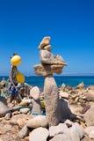 Stone figures on beach shore of Illetes beach in Formentera Royalty Free Stock Photo