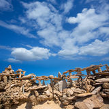 Stone figures on beach shore of Illetes beach in Formentera Royalty Free Stock Images