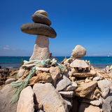 Stone figures on beach shore of Illetes beach in Formentera Stock Photography