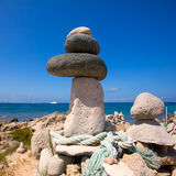 Stone figures on beach shore of Illetes beach in Formentera Stock Image