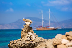 Stone figures on beach shore of Illetes beach in Formentera Royalty Free Stock Image