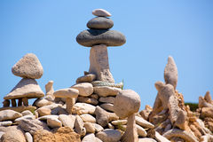 Stone figures on beach shore of Illetes beach in Formentera Royalty Free Stock Photo