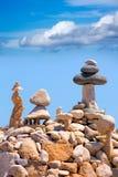 Stone figures on beach shore of Illetes beach in Formentera Stock Photo