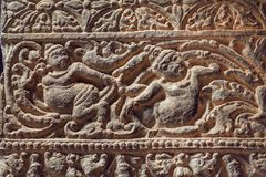 Stone figures of people on carved wall inside the 6th century cave temple, art of India Royalty Free Stock Photos