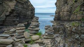 Stone figures at scottish coast. Stone figures at the scottish north coast stock image