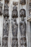 Stone figures at a side entrance of the cologne cathedral Stock Photography