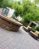 Stone fire pit and chairs Stock Photos