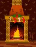 Stone fire-place with a christmas decorations Stock Image
