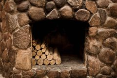 Stone fireplace with hearth and logs stock photography