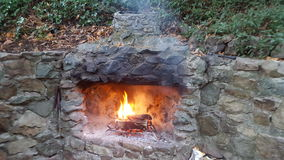Stone fireplace Royalty Free Stock Images