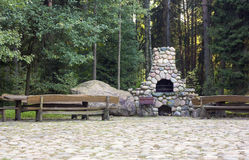Stone fireplace in a rural homestead Royalty Free Stock Photography